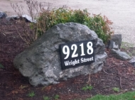 address plaque on rock