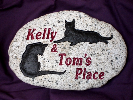 2 cats live here in great stone
