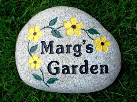 Marches garden stone with engraved flowers