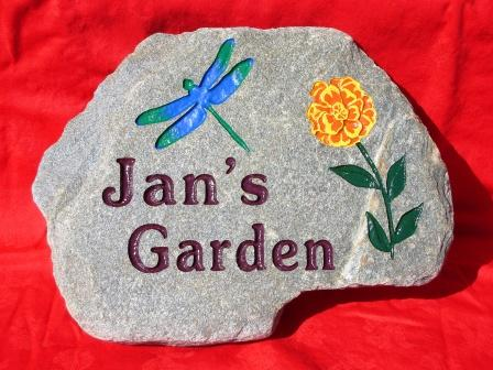Chan's garden stone with a dragonfly in the Mary gold