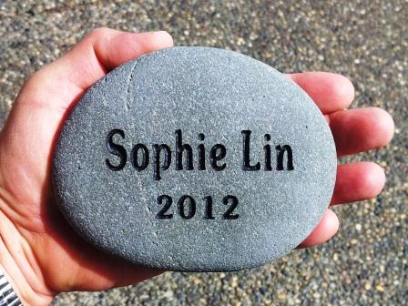 Hand sized stone engraved with the grandchild's name