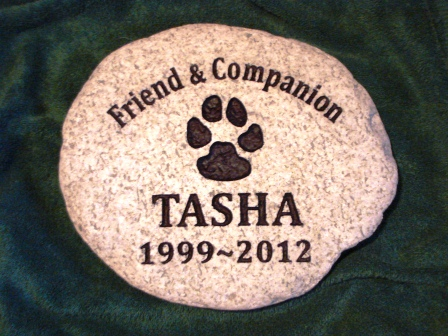 A good friend Tasha remembered with a paw print in stone