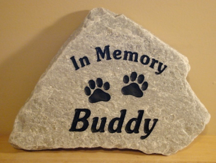 Buddy remembered forever with pawprints in stone