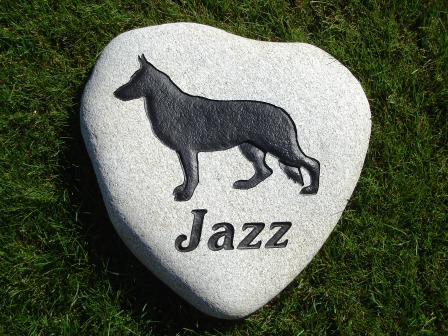 The German Shepherd Jazz on a heart shaped River rock
