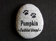 "A faithful friend ""Pumpkin"" remembered forever engraved on a River rock"