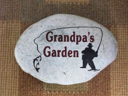Grandpas garden stone with a fisherman