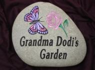Grandma Dottie's garden stone pink rose in a pink butterfly