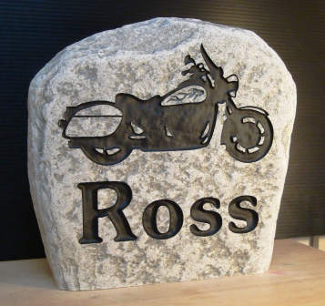 Engraved family name stone with a motorcycle