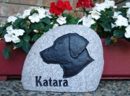 "Silhouette of the dog ""Katara"" engraved in stone"