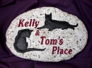 2 cats on a welcome stone