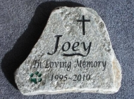 A paw print helps remember Joey in stone