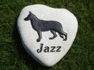The German Shepherd Jazz on a heart shaped River rock