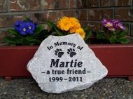 To paws engraved in stone for Marty